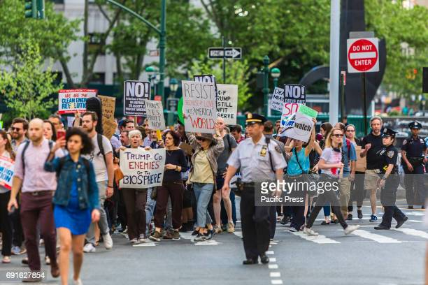 Hours after Donald Trump announced that he will withdraw the US from the Paris climate agreement hundreds in New York City protested in the streets