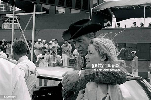 Hours of Sebring Car owner and builder Carroll Shelby walks down the pits talking with a female friend Shelby's car driven by Jerry Titus dominated...