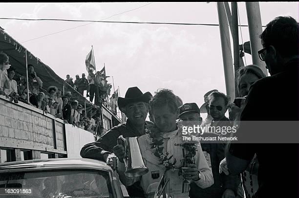 Hours of Sebring Race winner Jerry Titus celebrates in the pits with team owner and car builder Carroll Shelby