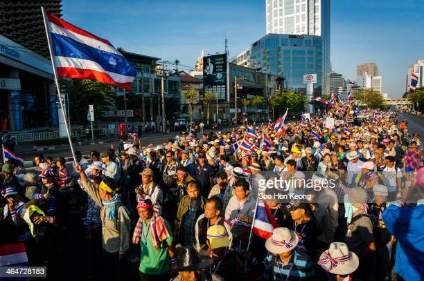 Housands of anti-government protesters march from Lumphini Park along Rama 4 towards the Customs Department on the second day of what has been termed...