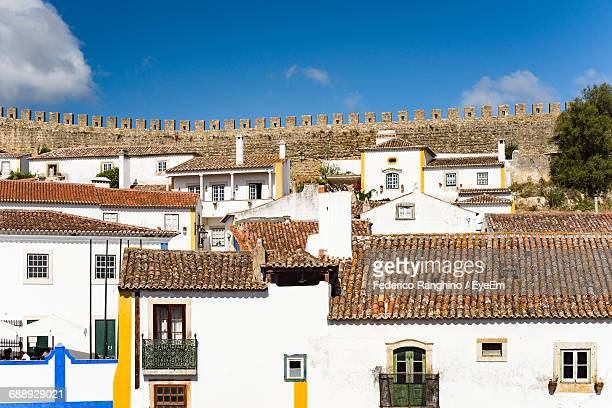 House Against Fortified Wall At Obidos