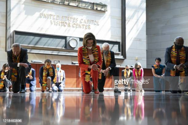 House and Senate Democrats bow their heads during a moment of silence in Emancipation Hall at the US Capitol in Washington DC US on Monday June 8...