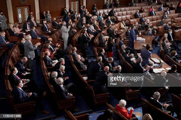 House and Senate Republicans applaud Rep. Paul Gosar and Sen. Ted Cruz during a joint session of Congress to count the Electoral College votes from...
