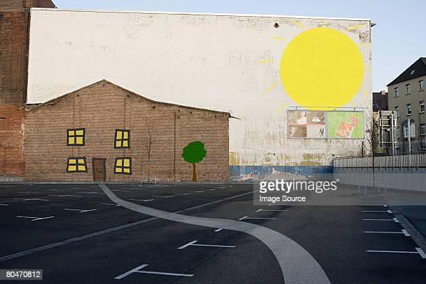 house and sun painted on wall - irony stockfoto's en -beelden