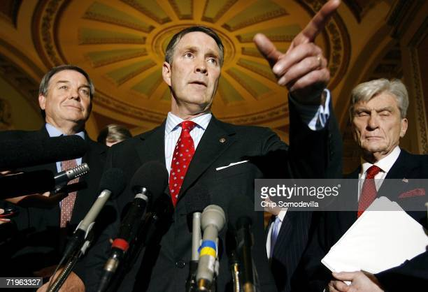 House Armed Services Committee Chairman Duncan Hunder Senate Majority Leader Bill Frist and Senate Armed Services Committee Chairman John Warner hold...