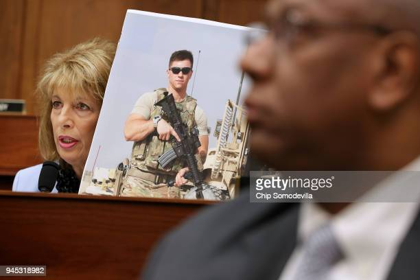 House Armed Services Committee member Rep Jackie Speier holds a photograph of Air Force Staff Sgt Logan Ireland while questioning Defense Secretary...