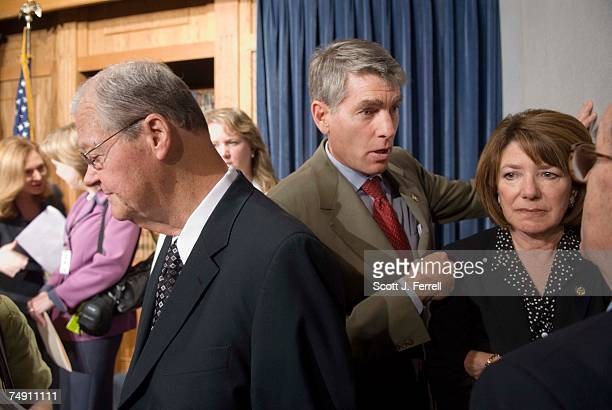 House Armed Services ranking member Ike Skelton DMo Rep Mark Udall DColo and Rep Susan A Davis DCalif talk to reporters after a news conference with...