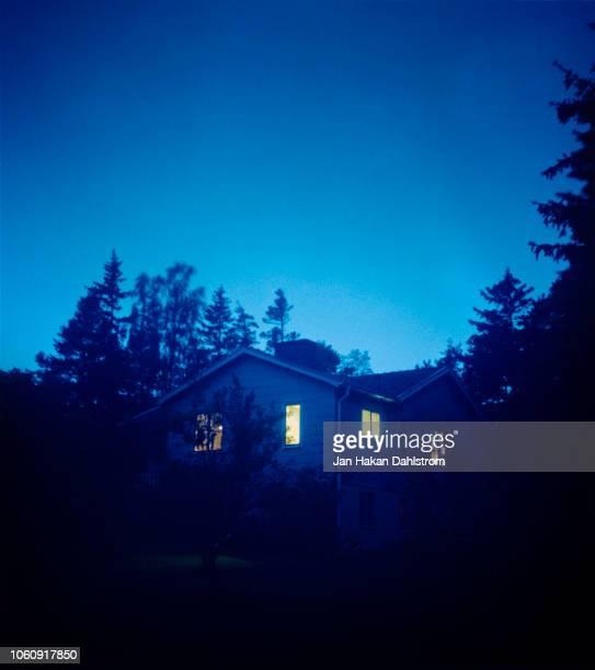 House At Dusk With Illuminated Windows