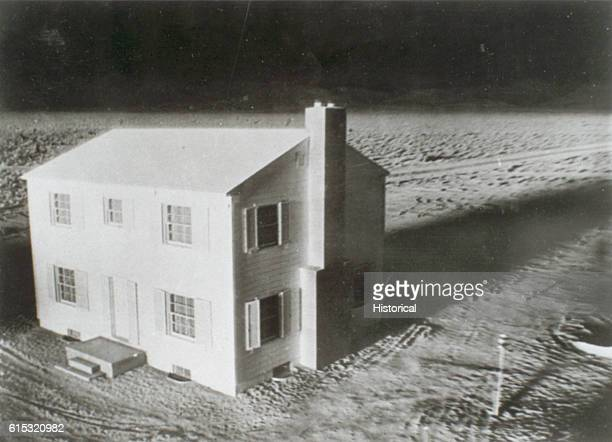 A house at Survival City about to be torn apart by the Annie blast of Operation UPSHOTKNOTHOLE