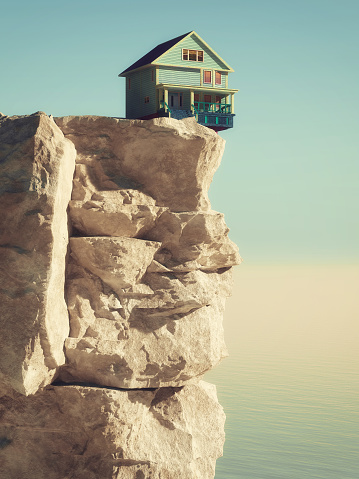 House at the edge of the abyss on a mountain peak at high altitude. This is a 3d render illustration. 1153147830
