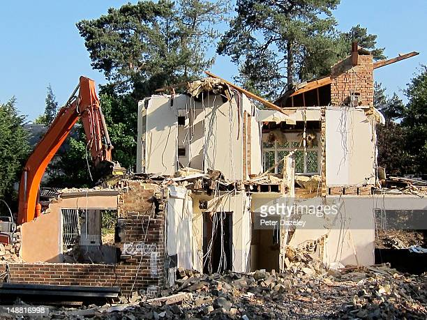 a house being demolished - demolishing stock pictures, royalty-free photos & images