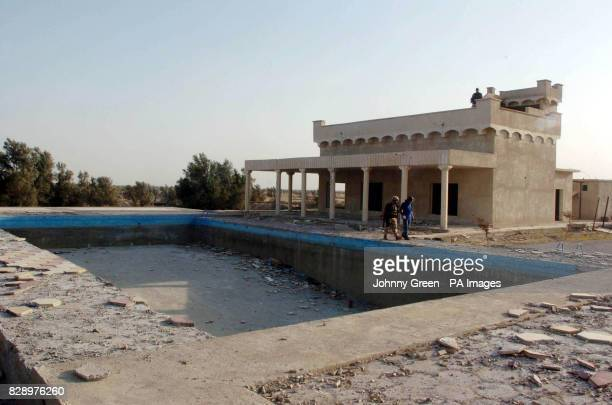 A house belonging to Ali Hassan alMajid the notorious henchman and cousin of Saddam Hussein known as Chemical Ali lies in extreme disrepair after...