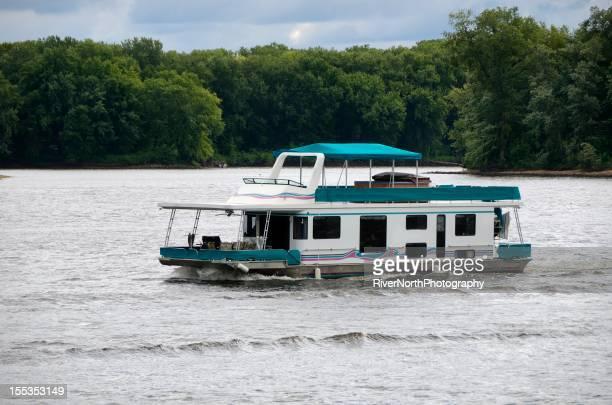 House Boat Floating on Mississippi River