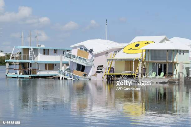 House boats are seen damaged from Hurricane Irma after it passed through the area on September 13 2017 in Key West Florida The Florida Keys still...