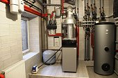 House boiler, water heater, expansion tank and other pipes. newmodern independent heating system in boiler room