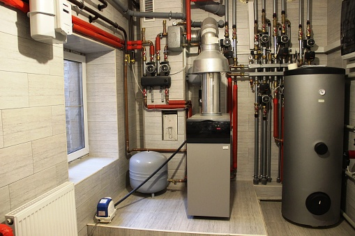 House boiler, water heater, expansion tank and other pipes. newmodern independent heating system in boiler room 1165699955