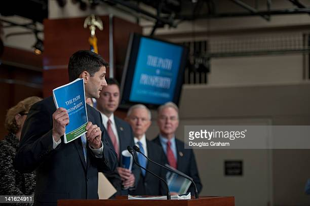 House Budget Chairman Paul Ryan RWis flanked by Sen Jeff Sessions RAL and members of the House Budget Committee during the House Budget Committee's...