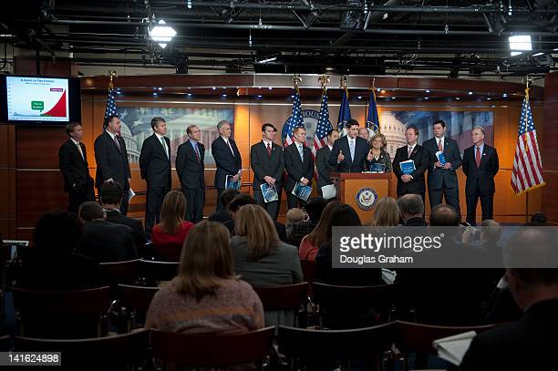 House Budget Chairman Paul Ryan RWis flanked members of the House Budget Committee during the House Budget Committee's news conference on the...
