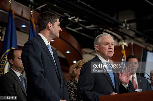 House Budget Chairman Paul Ryan RWis Sen Jeff Sessions RAL and members of the House Budget Committee during the House Budget Committee's news...