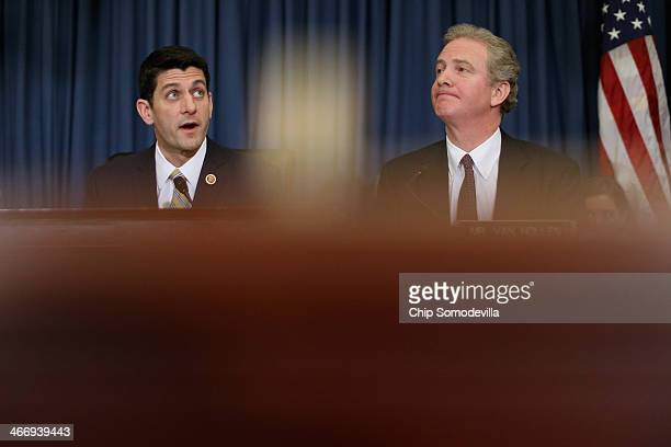 House Budget Committee Chairman Paul Ryan delivers opening remarks as ranking member Rep. Chris Van Hollen listens during a hearing in the Cannon...