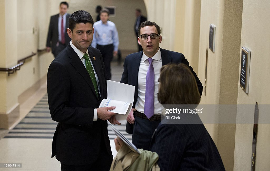 House Budget Committee chairman Paul Ryan, R-Wisc., left, thinks for a moment as a Capitol visitor asks for directions in the basement of the Capitol on Tuesday, March 19, 2013.
