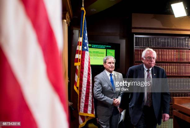 House Budget ranking member John Yarmuth DKy left and Senate Budget ranking member Bernie Sanders IVt arrive for their news conference to discuss the...