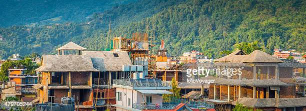 house building workers on bamboo scaffolding pokhara panorama himalayas nepal - pokhara stock pictures, royalty-free photos & images