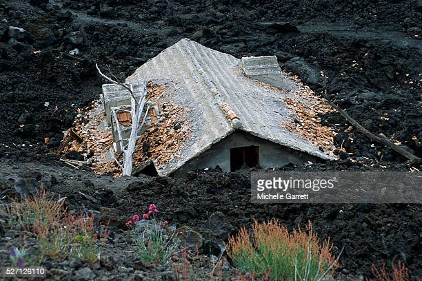house buried in lava from mount etna eruption - volcanic activity stock pictures, royalty-free photos & images