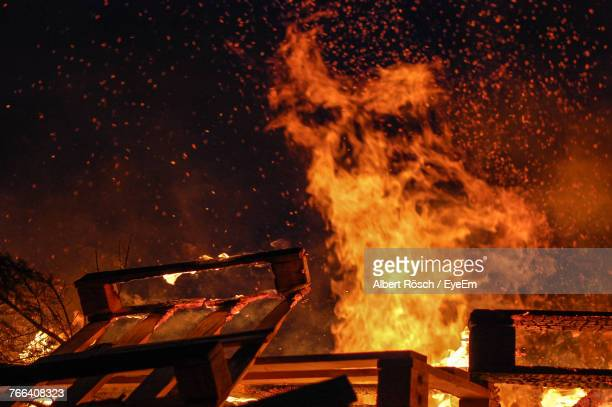 house burning at night - burning stock pictures, royalty-free photos & images