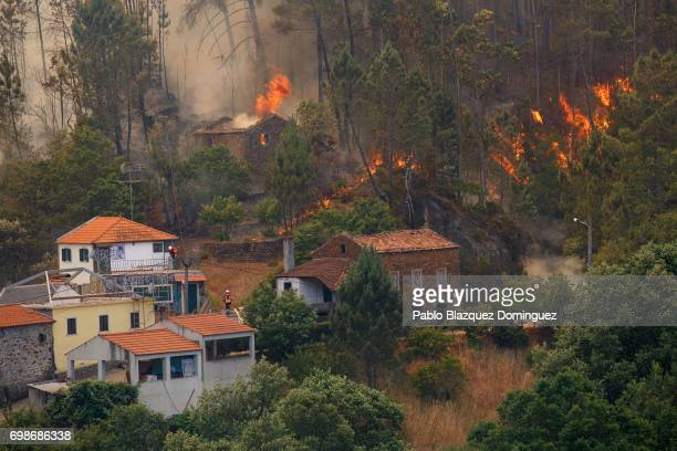 A house burns as a wildfire approaches Mega Fundeira village after a wildfire took dozens of lives on June 20 2017 near Picha in Leiria district...