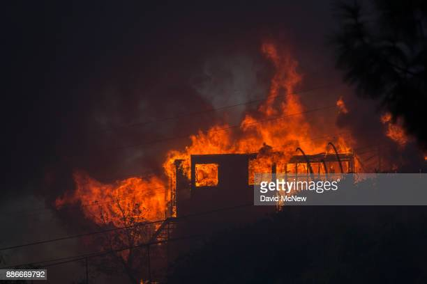 A house burns during the Creek Fire on December 5 2017 in Sunland California Strong Santa Ana winds are rapidly pushing multiple wildfires across the...