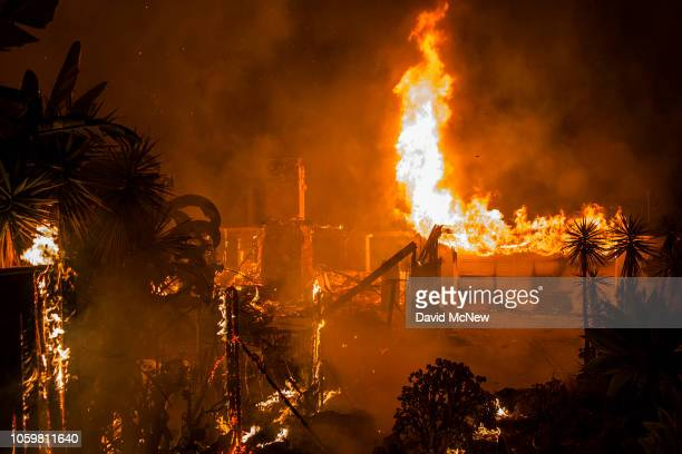 A house burns during the Woolsey Fire on November 9 2018 in Malibu California After a experiencing a mass shooting residents of Thousand Oaks are...