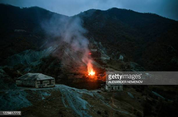 House burns in a village outside the town of Kalbajar, on November 14 after a peace agreement was signed to end the military conflict between Armenia...