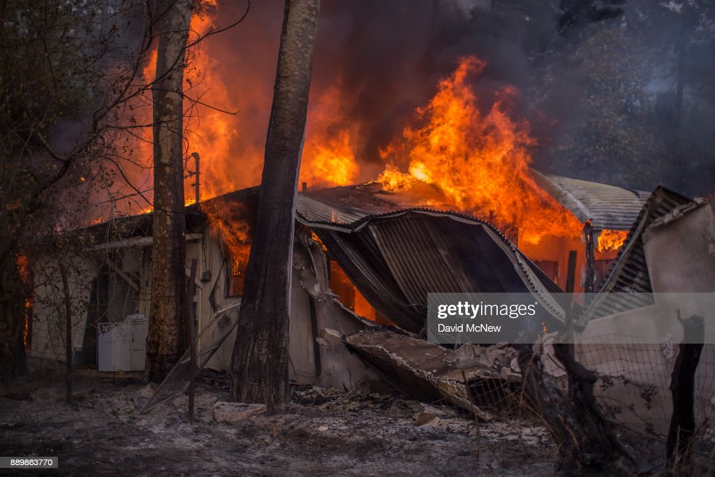 A house burns near Casitas Pass Road as the Thomas Fire continues to grow on December 10, 2017 near Carpinteria, California. The Thomas Fire has grown to 173,000 acres and destroyed at least 754 structures so far. Strong Santa Ana winds have been feeding major wildfires all week, destroying houses and forcing tens of thousands of people to evacuate.