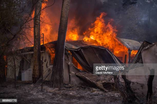 A house burns near Casitas Pass Road as the Thomas Fire continues to grow on December 10 2017 near Carpinteria California The Thomas Fire has grown...