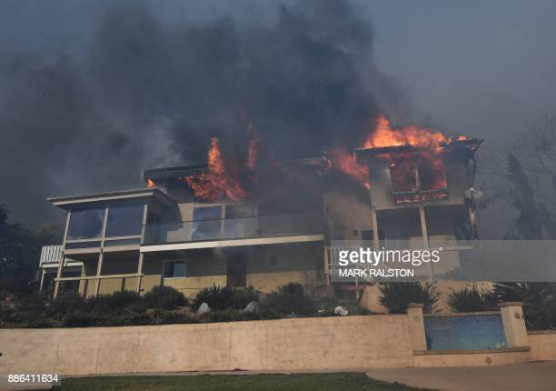 A house burns to the ground during the Thomas wildfire in Ventura California on December 5 2017 Fastmoving windfueled brush fire exploded to about...