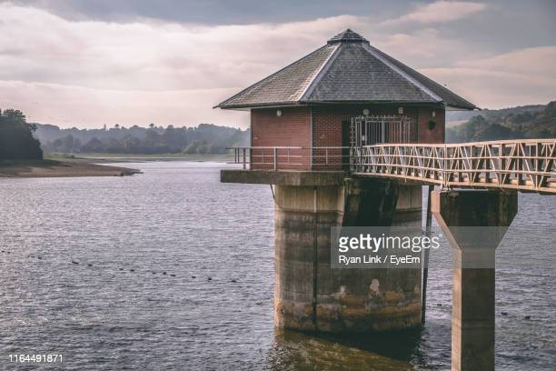house by sea against sky - leicester stock pictures, royalty-free photos & images