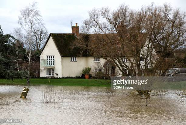 House by the river is surrounded by water. Widespread flooding in Bedford and surrounding villages, where the River Great Ouse has burst its banks....