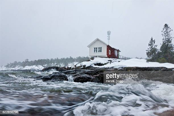 house by the sea at a winterstorm - philanthropist stock pictures, royalty-free photos & images