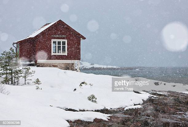 house by the sea at winterstorm - philanthropist stock pictures, royalty-free photos & images