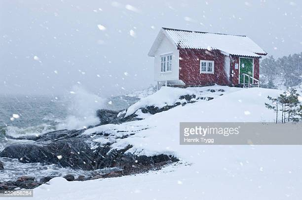 house by the sea in winter storm - philanthropist stock pictures, royalty-free photos & images