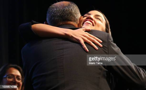 S House candidate Alexandria OcasioCortez R hugs a supporter at a progressive fundraiser on August 2 2018 in Los Angeles California The rising...