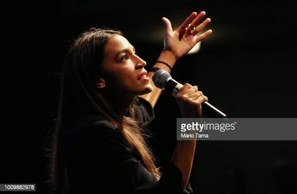 S House candidate Alexandria OcasioCortez speaks at a progressive fundraiser on August 2 2018 in Los Angeles California The rising political star is...