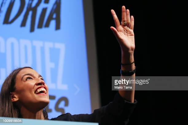 S House candidate Alexandria OcasioCortez waves to supporters at a progressive fundraiser on August 2 2018 in Los Angeles California The rising...