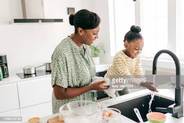 house chores for kids - chores stock pictures, royalty-free photos & images