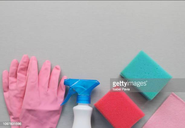 House cleaning supplies on grey background