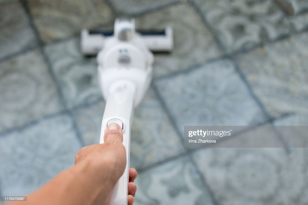 house cleaning with a vacuum cleaner, cleanliness in the apartment : Stock Photo