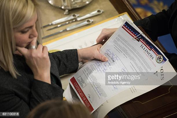 House Clerk staff verify the official Electoral College votes from the State of Illinois during a joint session of Congress at the US Capitol in...