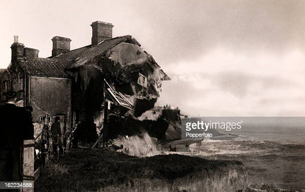 A house collapsing into the sea the extreme effects of coastal erosion at Pakefield near Lowestoft Suffolk circa 1930
