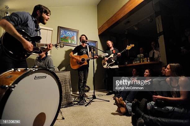 House concert at the home of Bodie Johnson in Boulder with the musician Joshua James from Salt Lake City on Thursday March 10 2011 Left to right Evan...